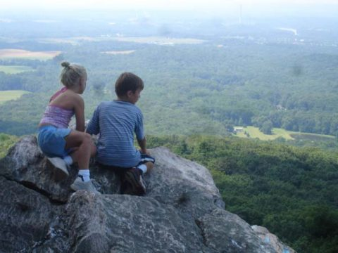 Children sitting on a rock at Sugarloaf Mountain